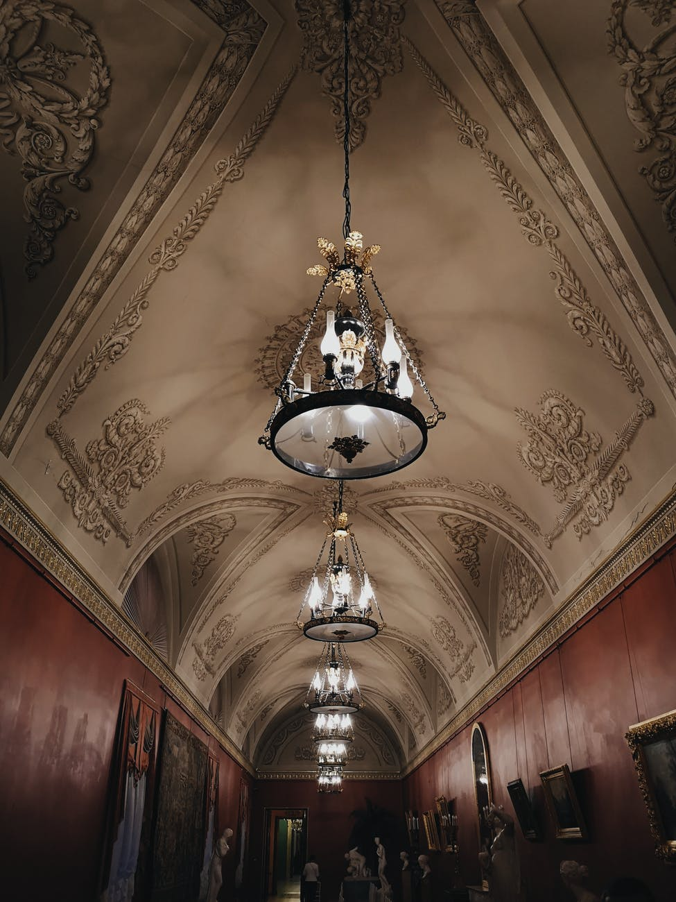 ballroom ceiling with chandeliers in a row